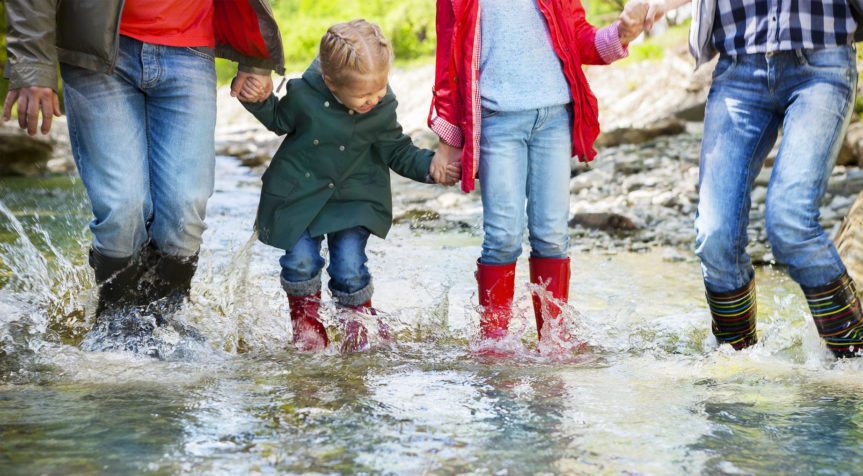 mess - family playing in a puddle